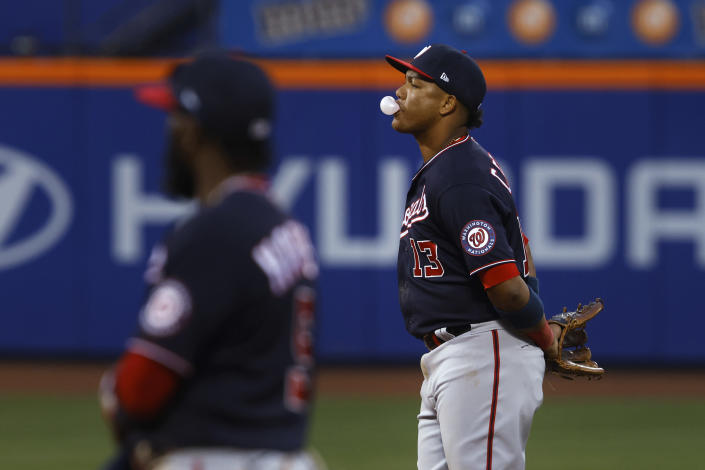 Washington Nationals' Starlin Castro blows a bubble during the eighth inning of the team's baseball game against the New York Mets, Saturday, April 24, 2021, in New York. (AP Photo/Jason DeCrow)