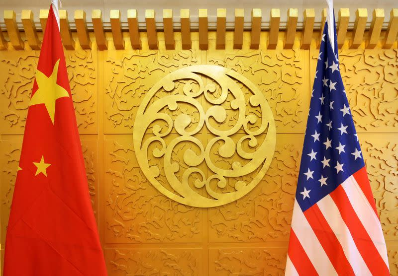 FILE PHOTO: Chinese and U.S. flags are set up for a meeting during a visit by U.S. Secretary of Transportation Elaine Chao at China's Ministry of Transport in Beijing