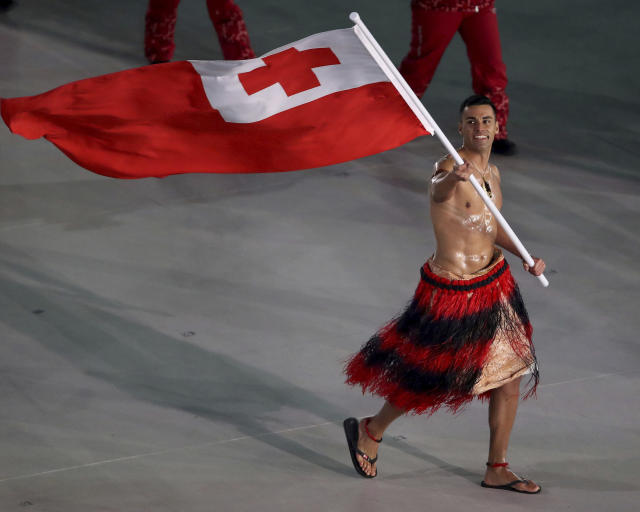<p>Pita Taufatofua carries the flag of Tonga during the opening ceremony of the 2018 Winter Olympics in Pyeongchang, South Korea, Friday, Feb. 9, 2018. (Sean Haffey/Pool Photo via AP) </p>