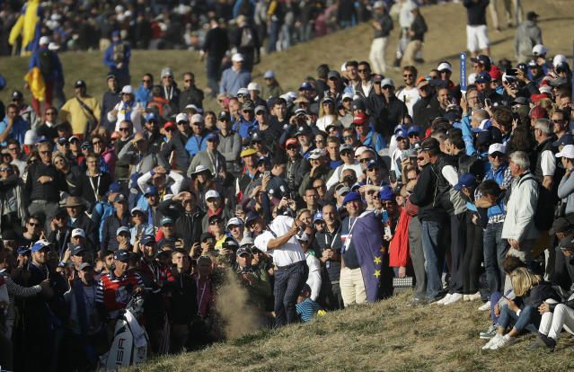 FILE - In a Sept. 29, 2018 photo, Brooks Koepka of the US plays out of the rough during a foursome match on the second day of the 42nd Ryder Cup at Le Golf National in Saint-Quentin-en-Yvelines, outside Paris, France. A decision is looming whether to play the Ryder Cup in Wisconsin in September 2020 with fans or even postpone it until next year. (AP Photo/Matt Dunham, File)