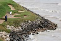 World number one Jon Rahm of Europe plays a shot from a lakeside bunker on the seventh hole during a practice round for the 43rd Ryder Cup, which begins Friday at Whistling Straits (AFP/Richard HEATHCOTE)