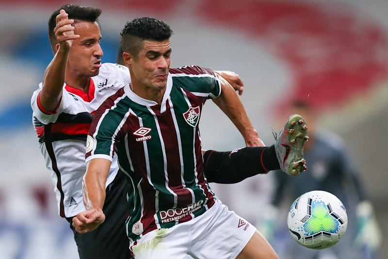 RIO DE JANEIRO, BRAZIL - SEPTEMBER 02: Egidio (R) of Fluminense struggles for the ball with Matheuzinho of Atletico GO during a match between Fluminense and Atletico GO as part of 2020 Brasileirao Series A at Maracana Stadium on September 02, 2020 in Rio de Janeiro, Brazil. (Photo by Buda Mendes/Getty Images)