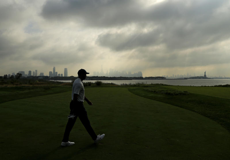 Tiger Woods early on Thursday morning at a nearly deserted Liberty National Golf Club. (Getty)