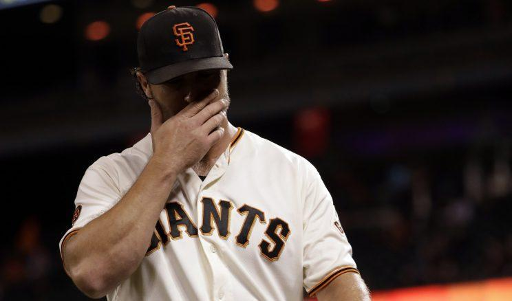 San Francisco Giants relief pitcher Hunter Strickland walks off the field after being pulled from the game during the ninth inning of a baseball game against the San Diego Padres Tuesday, Sept. 13, 2016, in San Francisco. San Diego won 6-4. (AP Photo/Marcio Jose Sanchez)