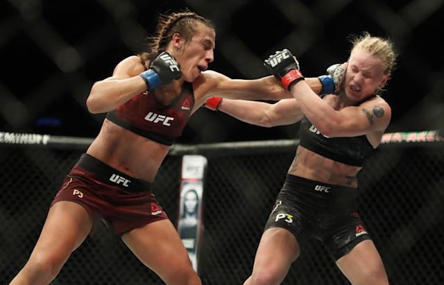 Joanna Jedrzejczyk (L) has shown she can take hits and keep storming forward. (Steve Russell/Toronto Star via Getty Images)