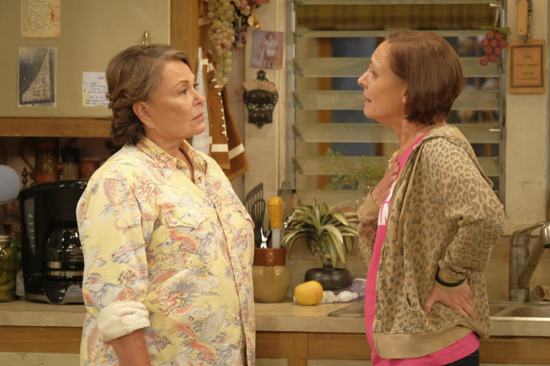"In this image released by ABC, Roseanne Barr, left, and Laurie Metcalf appear in a scene from the reboot of the popular comedy series ""Roseanne."" ABC, which canceled its ""Roseanne"" revival over its star's racist tweet, said Thursday, June 21, 2018, it will air a Conner family sitcom minus Roseanne Barr this fall. (Adam Rose/ABC via AP)"