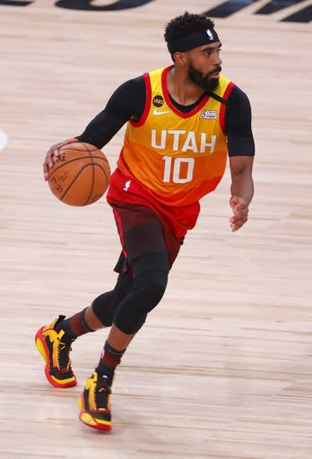 Back from quarantine, Conley leads Jazz over Nuggets 124-87