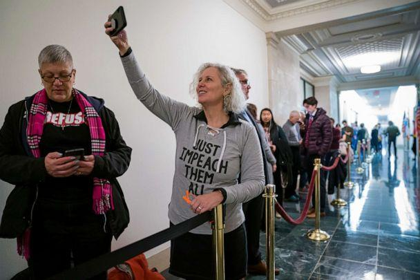 PHOTO: Jennifer Fisher, center, and Cathy Marino-Thomas, left, both of New York City, wait in line to attend a hearing by the House Judiciary Committee on Capitol Hill in Washington, Dec. 4, 2019. (J. Scott Applewhite/AP)