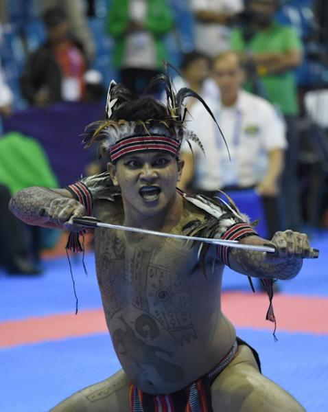 Arnis has made a triumphant return to the Southeast Asian Games (AFP Photo/WAKIL KOHSAR)