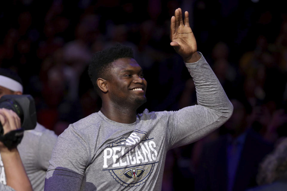 New Orleans Pelicans forward Zion Williamson (1) enters the court during introductions before the start of an NBA basketball game in New Orleans, Sunday, March 1, 2020. (AP Photo/Rusty Costanza)