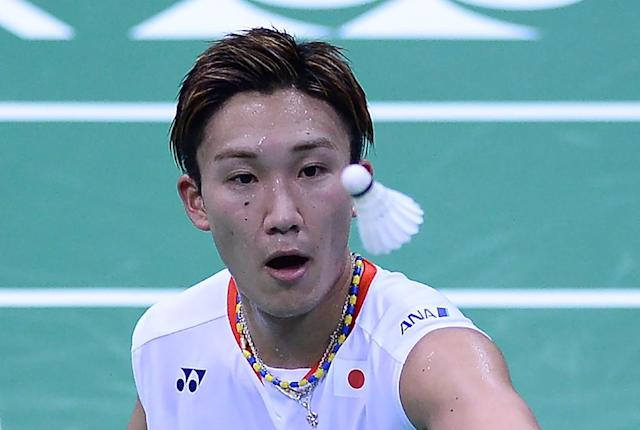 Japan's Kento Momota, world number 2, may not be allowed to play at the Olympics in Rio this year (AFP Photo/Sajjad Hussain)