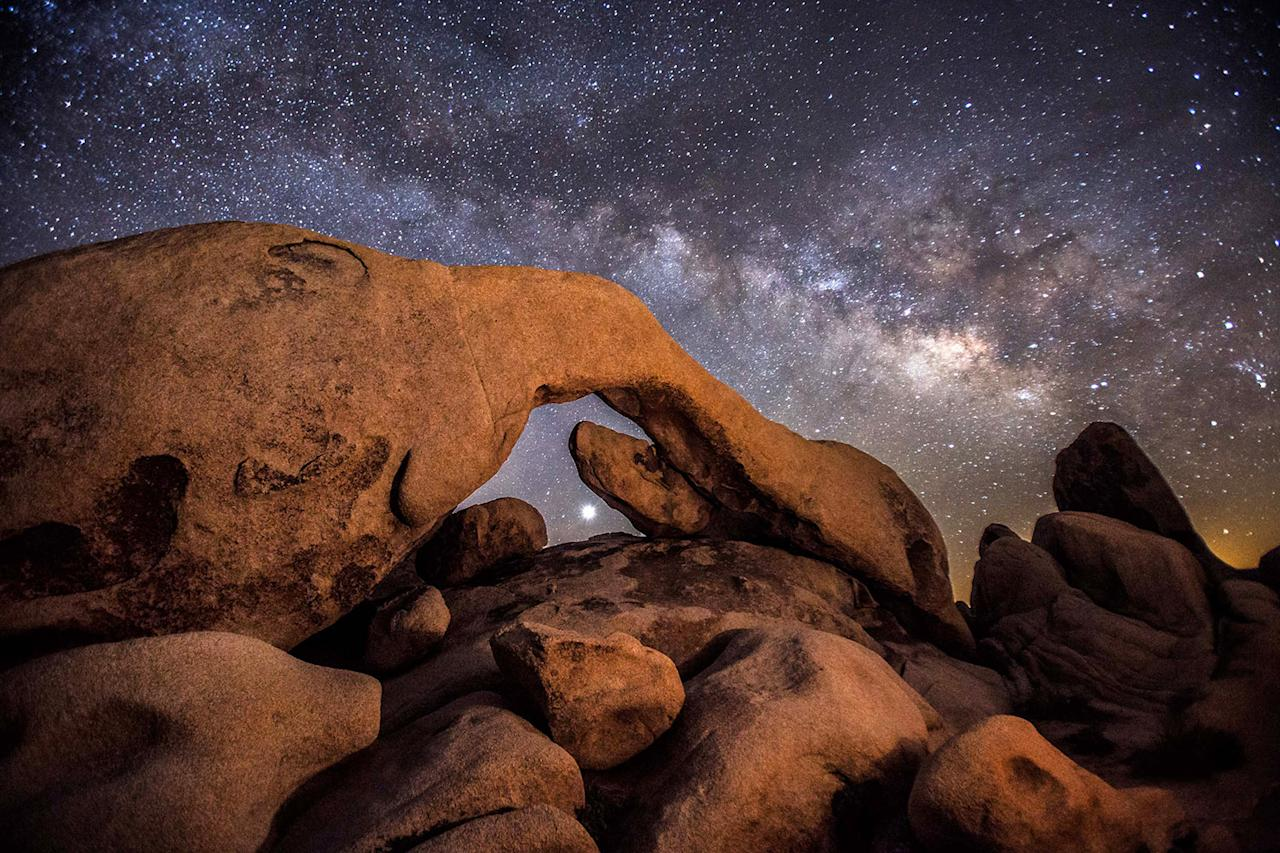 """<p>He said: """"I was fascinated by the unique desert landscapes of massive sandstone geological arch formations coupled with dark skies, free from most light pollution."""" (Photo: Brad Goldpaint/Caters News) </p>"""