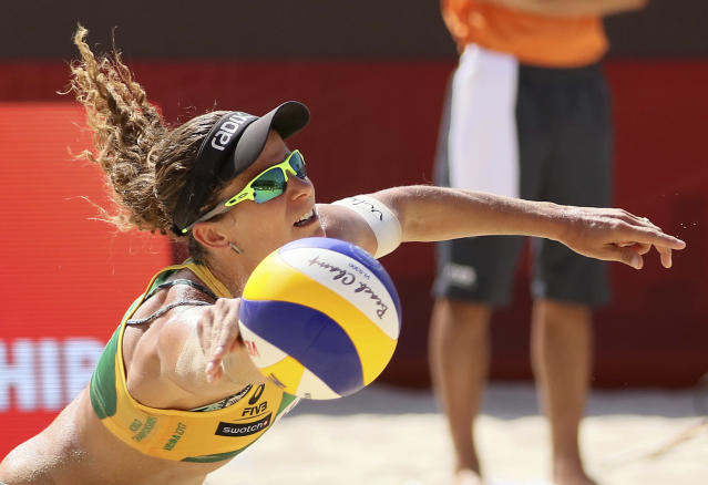 Brazil's Larissa Franca Maestrini dives for a ball while playing against Swiss team during the women's round of 16 at the Beach Volleyball World Championships in Vienna, Austria, Thursday, Aug. 3, 2017. (AP Photo/Ronald Zak)