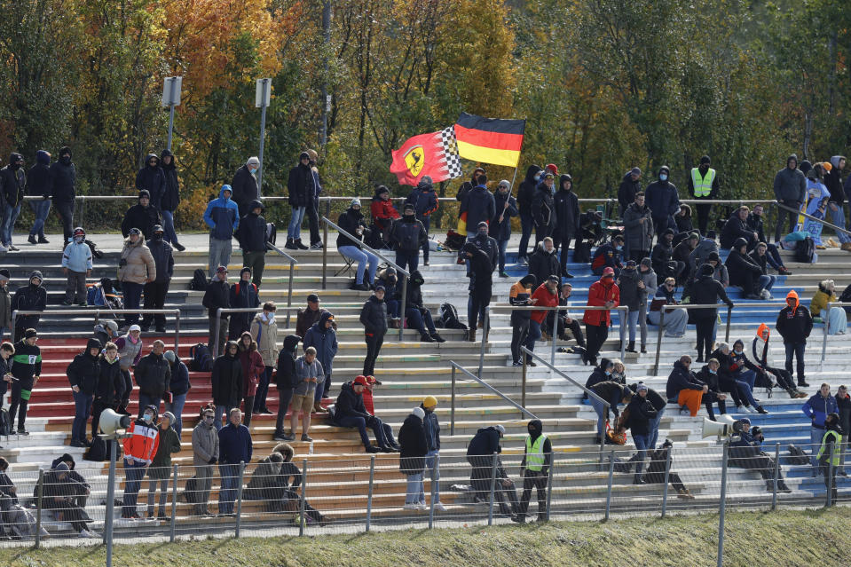 Spectators are on stands ahead of qualification for the Eifel Formula One Grand Prix at the Nuerburgring racetrack in Nuerburg, Germany, Saturday, Oct. 10, 2020. The Germany F1 Grand Prix will be held on Sunday. (Ronald Wittek, Pool via AP)