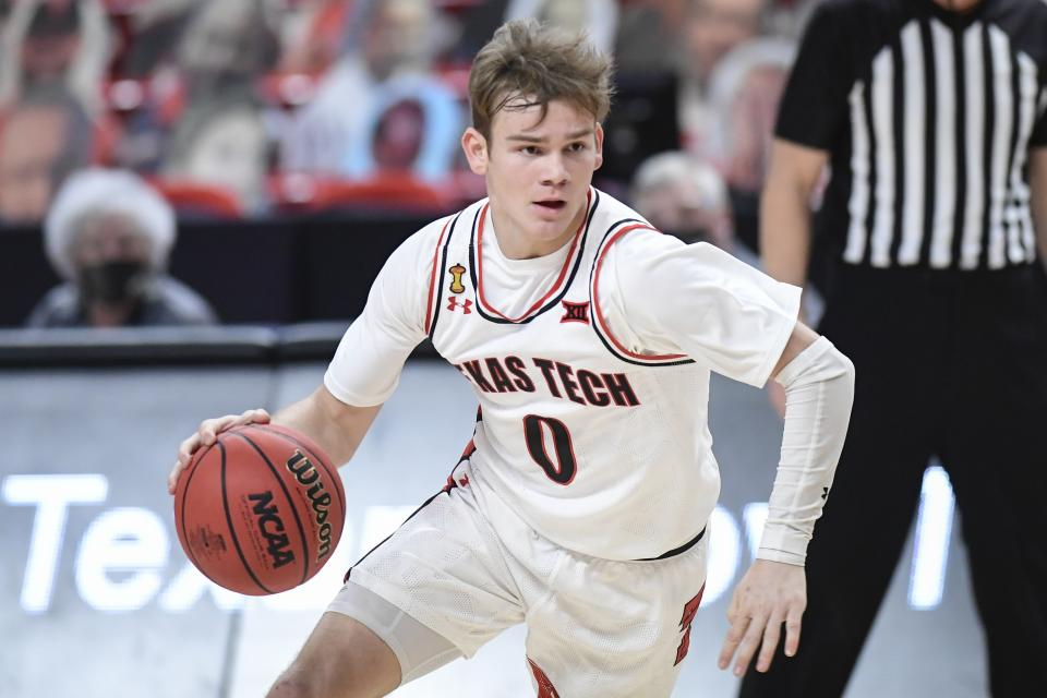 Texas Tech's Mac McClung (0) controls the ball during the first half of an NCAA college basketball game against Iowa State in Lubbock, Texas, Thursday, March 4, 2021. (AP Photo/Justin Rex)