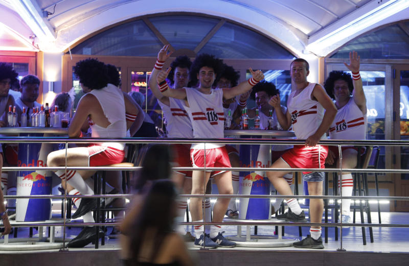 MAGALUF, SPAIN - JUNE 30: Tourists visit the popular Punta Ballena strip on June 30, 2019 in Magaluf, Spain. Magaluf, where most of the nightclubs and bars are located, is one of the main destinations for British tourists during the summer season. (Photo by Clara Margais/Getty Images)