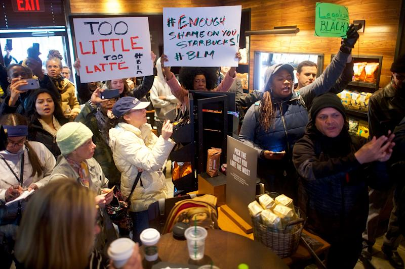 Protestersdemonstrate in aPhiladelphia Starbucks on April 15, 2018, days after an employee at a Starbucks in that city called the police to report two black men waiting to meet a friend.
