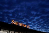 FILE PHOTO: Signage for Sainsbury's is seen at a branch of the supermarket in London