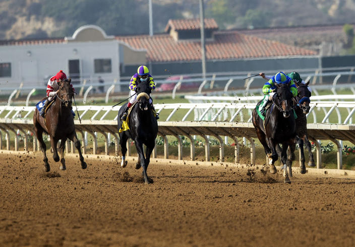 In this image provided by Benoit Photo, Extra Hope, second from right, with Juan Hernandez aboard, wins the Grade III, $100,000 Native Diver Stakes horse race Saturday, Nov. 21, 2020, at Del Mar Thoroughbred Club in Del Mar, Calif. (Benoit Photo via AP)