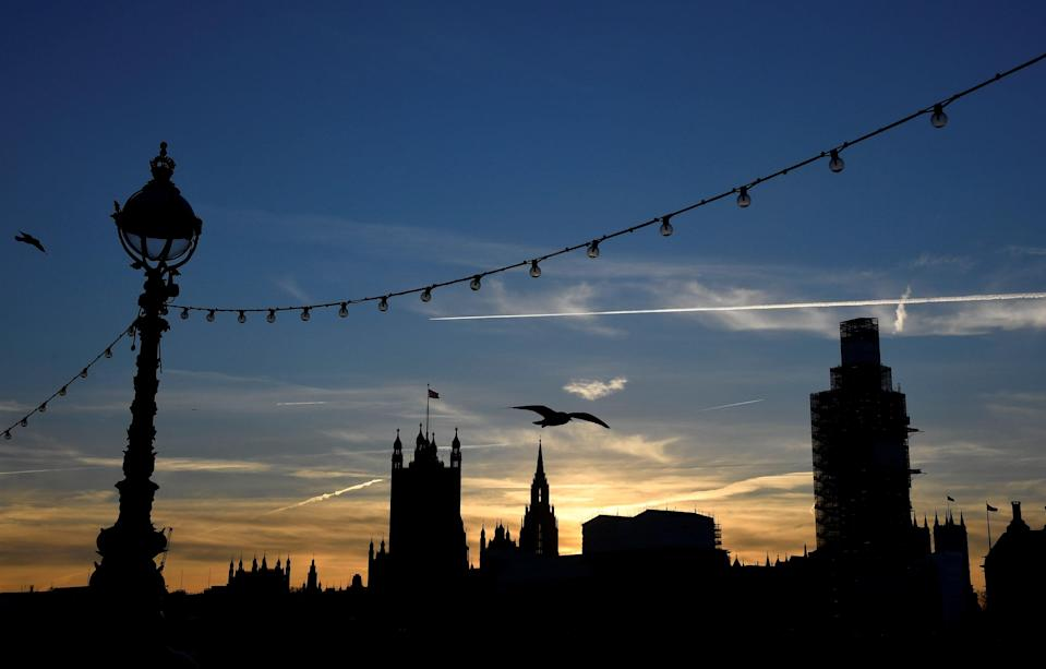 The sun sets behind the Houses of Parliament in Westminster London, Britain. Photo: REUTERS/Toby Melville