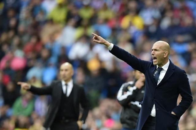 Real Madrid's coach Zinedine Zidane gestures during the Spanish league match Real Madrid CF vs Valencia CF in Madrid on May 8, 2016