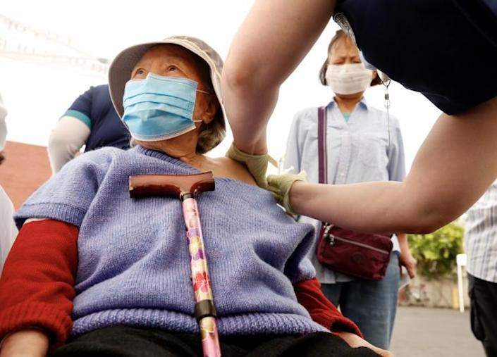 LOS ANGELES CA APRIL 20, 2021 - Yong-Im Kim, 91 gets shot as her daughter Kyong-Sok Kim watches nursing student Briana Shaw give the Pfizer vaccine at the Hollywood Presbyterian Medical Center on April 20, 2021. CORE has partnered with Charles R. Drew University of Medicine and Science to provide student volunteers for on-site registration allowing for walk-up appointments for community members and further ensuring vaccine access in our hardest-hit communities. (Al Seib / Los Angeles Times)