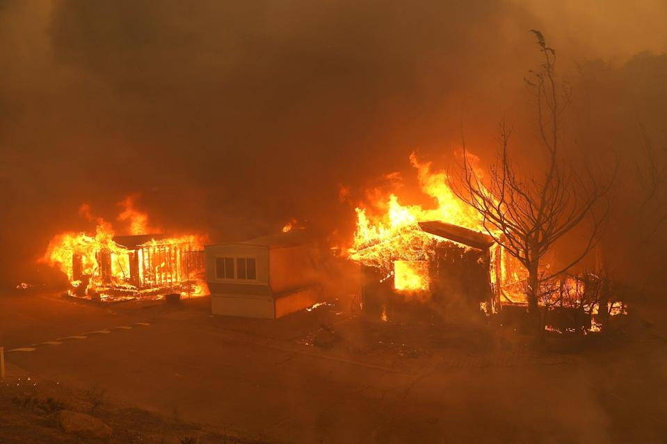 Mobile homes ablaze during last year's devastating wildfires in Napa, California (Getty)