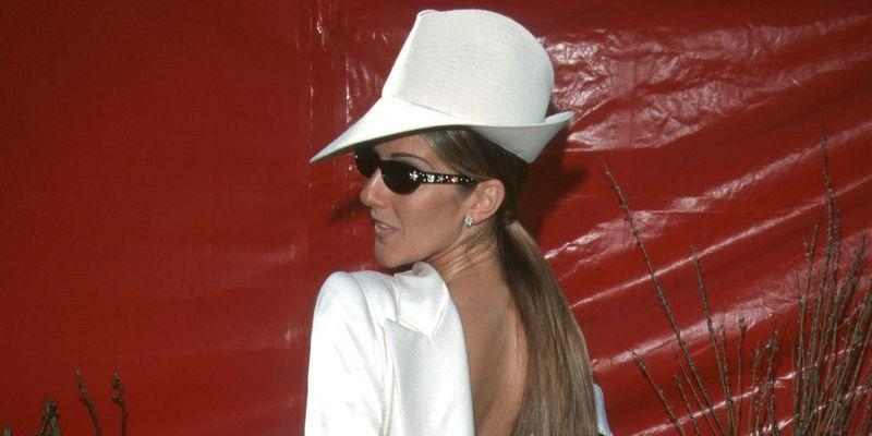 <p>In one of her most iconic looks of all time, Dion showed up to the '99 Academy Awards wearing a white tuxedo blazer backwards. The unforgettable John Galliano look was topped off with a hat and black rectangular sunglasses. </p>