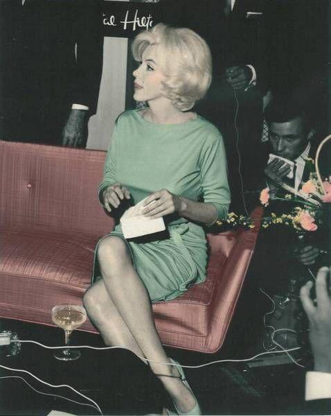 """<p>Monroe sits in a mint green jersey Emilio Pucci dress at a press conference in Mexico, February 1962. It is <a href=""""http://themarilynmonroecollection.com/marilyn-monroe-green-pucci-belt/"""" target=""""_blank"""">rumored</a> that she was later buried in this garment.</p>"""