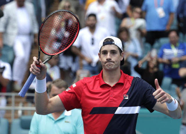 John Isner celebrates after defeating Felix Auger-Aliassime, of Canada, during their semifinal match at the Miami Open tennis tournament, Friday, March 29, 2019, in Miami Gardens, Fla. Isner won 7-6 (3), 7-6 (4). (AP Photo/Lynne Sladky)