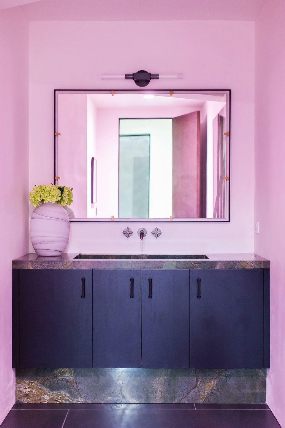<p>Want your bathroom to bright and unique without the hassle and commitment of paint? Take note of this powder room by Breegan Jane, where circadian-rhythm color lights turn the cream walls temporarily pink. </p>