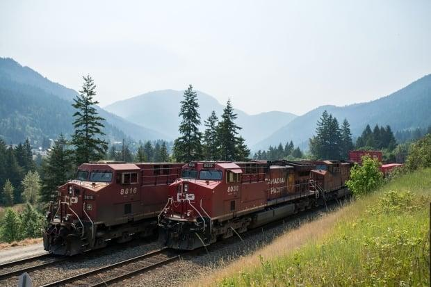 Canadian Pacific Railway locomotives sit idle in the Fraser Canyon south of Lytton, B.C., which was destroyed in a wildfire last week. Fire damage to rail lines in B.C.'s Interior caused trains to back up, idling thousands of rail cars and stranding their contents. ( James MacDonald/Bloomberg - image credit)