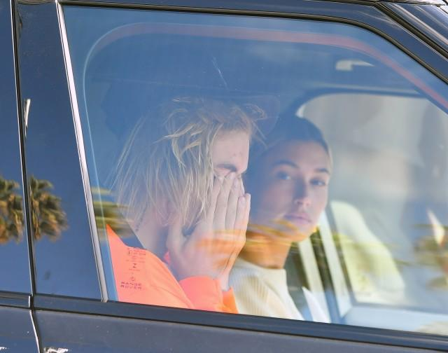 Justin Bieber looks worse for wear as he and Hailey Baldwin drive to their Pastor's house in Beverly Hills. Justin Appears to be crying.