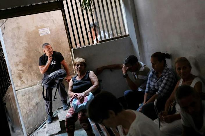 Patients wait at the spiritual healer's clinic in Petare (AFP Photo/Matias Delacroix)