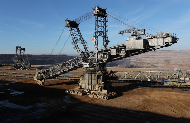FILE PHOTO: Excavators of German utility RWE stand in the open-cast brown coal mining area of Hambach