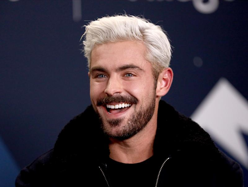 Zac Efron looks dazzling in blonde hair with an amazing smile on his face