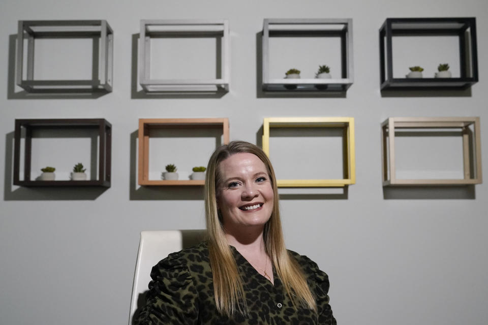 Olivia Banks, an account manager at Element Designs poses for a picture on Tuesday, Nov. 17, 2020, in Charlotte, N.C. Some companies are turning health insurance shopping over to employees, but they aren't leaving them empty handed. They're sending workers to individual insurance markets to find coverage and then reimbursing them at least partially for the cost. Banks found the new approach daunting at first, but a company hired by her employer, helped Banks figure out which plans would include her doctors and what sort of expenses she could handle. (AP Photo/Chris Carlson)