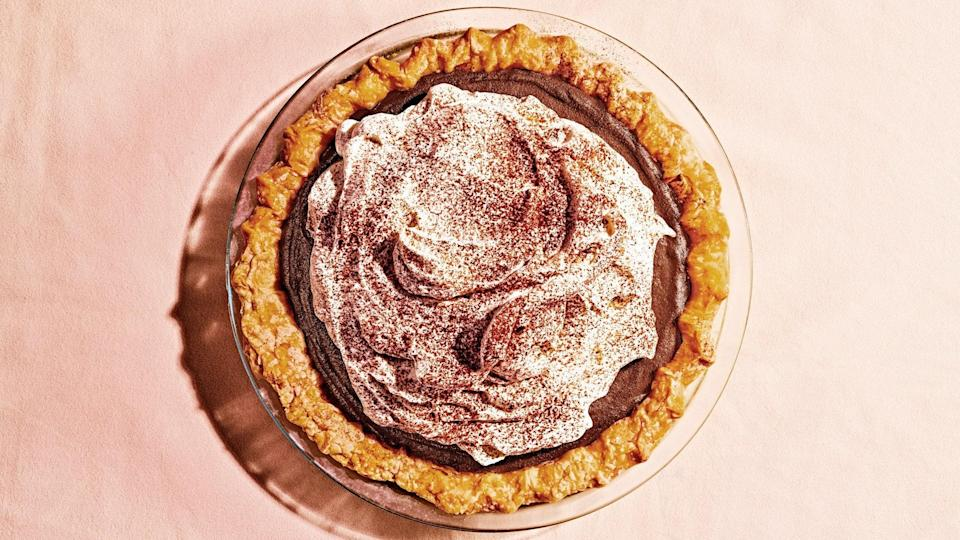 """<p>A dazzling chocolate pudding pie cloaked in voluminous whipped cream. The secret to that whipped cream's great height: Setting it with dissolved gelatin means it won't deflate or weep when chilled. </p>   <p><em>Like this</em> Bon Appétit <em>recipe? There are plenty more where this came from.</em> <a href=""""https://subscribe.bonappetit.com/subscribe/bonappetit/122921?source=HCL_BNA_SUBSCRIBE_LINK_0_EPICURIOUS_ZZ"""" rel=""""nofollow noopener"""" target=""""_blank"""" data-ylk=""""slk:Subscribe to the magazine here!"""" class=""""link rapid-noclick-resp""""><em>Subscribe to the magazine here!</em></a></p> <a href=""""https://www.epicurious.com/recipes/food/views/chocolate-pudding-pie?mbid=synd_yahoo_rss"""" rel=""""nofollow noopener"""" target=""""_blank"""" data-ylk=""""slk:See recipe."""" class=""""link rapid-noclick-resp"""">See recipe.</a>"""