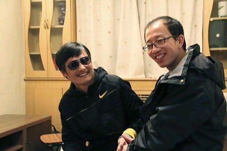 This undated photo provided by the China Aid Association shows blind Chinese legal activist Chen Guangchen, left, with Hu Jia sometime after Chen escaped house arrest on April 22, 2012. Activists say Chen, a well-known dissident who angered authorities in rural China by exposing forced abortions, is under the protection of U.S. diplomats in Beijing, posing a delicate diplomatic crisis for both governments. (AP Photo/www.ChinaAid.org)