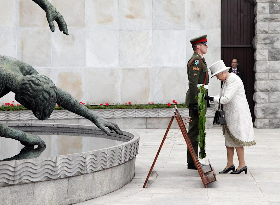 DUBLIN, IRELAND - MAY 17: Queen Elizabeth II lays a wreath at the Garden of Remembrance on May 17, 2011 in Dublin, Ireland. The Duke and Queen's visit is the first by a monarch since 1911. An unprecedented security operation is taking place with much of the centre of Dublin turning into a car free zone. Republican dissident groups have made it clear they are intent on disrupting proceedings.  (Photo by Irish Government - Pool/Getty Images)