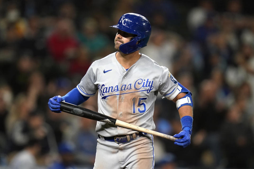 Kansas City Royals' Whit Merrifield turns away from the plate after he lined out to end the top of the fifth inning of the team's baseball game against the Seattle Mariners on Friday, Aug. 27, 2021, in Seattle. (AP Photo/Elaine Thompson)