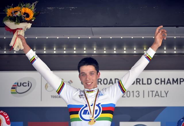 Belgian cycling star Igor Decraene on September 24, 2013 on the podium after winning the men's juniors time trial race at the World Cycling championships in Florence (AFP Photo/Eric Lalmand)