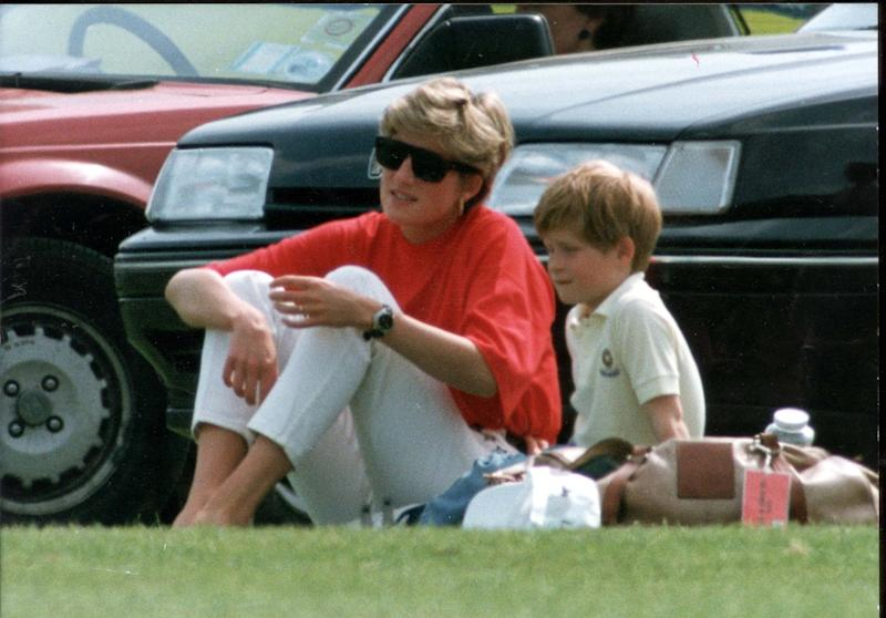 A young Prince Harry with his mother (Getty)