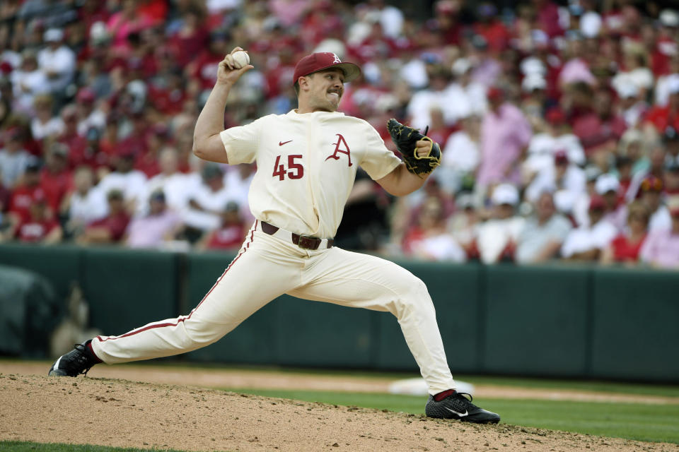 FILE - Arkansas pitcher Kevin Kopps throws a pitch against Mississippi during the sixth inning of Game 2 at the NCAA college baseball super regional tournament in Fayetteville, Ark., in this Sunday, June 9, 2019, file photo. Top-ranked Arkansas is closing in on its first SEC championship in baseball since 2004 after winning two of three one-run games at Tennessee. (AP Photo/Michael Woods, File)