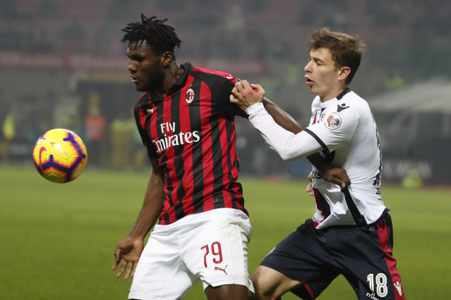 AC Milan's Franck Kessie, left, and Cagliari's Nicolo Barella challenge for the ball during the Serie A soccer match between AC Milan and Cagliari at the San Siro stadium, in Milan, Italy, Sunday, Feb. 10, 2019. (AP Photo/Antonio Calanni)