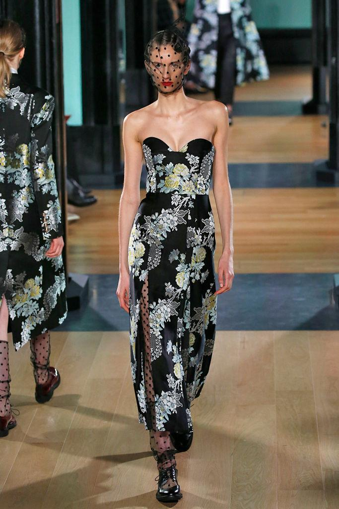 <p>A black floral strapless dress at the Erdem FW18 show. (Photo: Getty) </p>