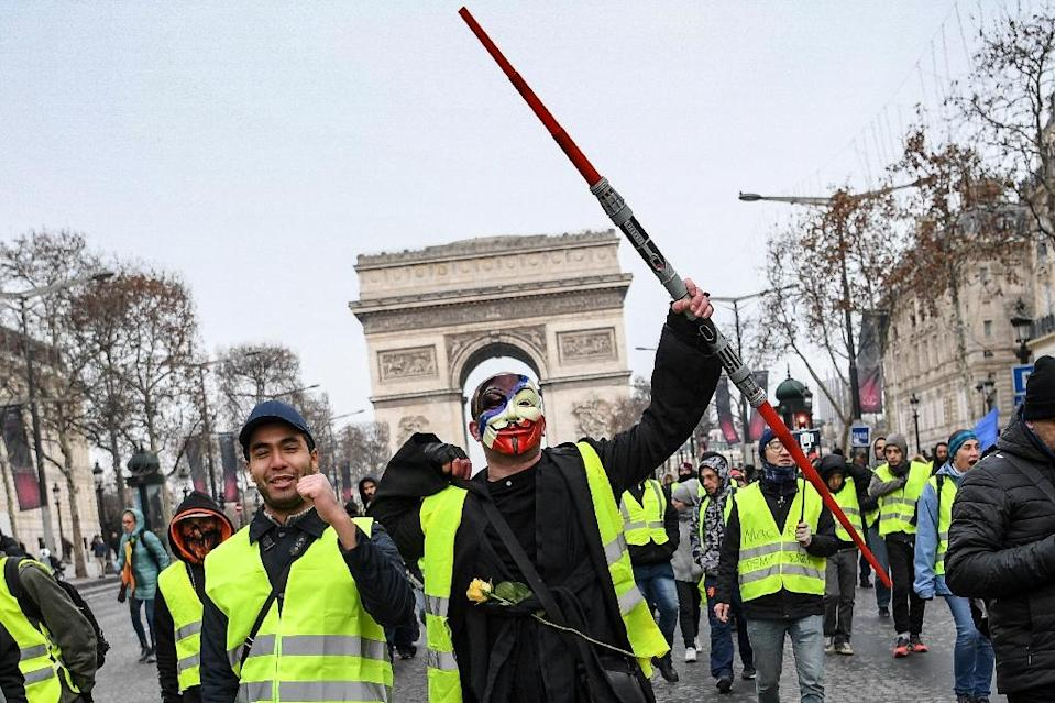 "So-called ""yellow vest"" protesters gathered on the Champs Elysees in Paris on Saturday (AFP Photo/CHRISTOPHE ARCHAMBAULT )"