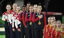 <p>Simone Biles (USA) of USA, Gabrielle Douglas (USA) of USA (Gabby Douglas), Laurie Hernandez (USA) of USA, Madison Kocian (USA) of USA, Alexandra Raisman (USA) of USA (Aly Raisman) sing their national anthem with their gold medals on the podium after winning the women's team final. On right are bronze medallists China, with silver medallists Russia at the back. REUTERS/Dylan Martinez </p>