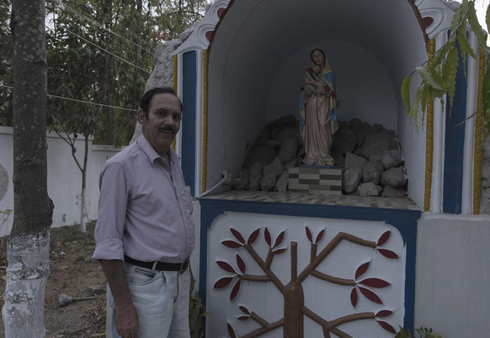 John Hourigan (61), one of the Anglo-Indians living at McCluskiegunj, poses for a portrait in front of a Mother Mary statue in the premises of Don Bosco Academy.