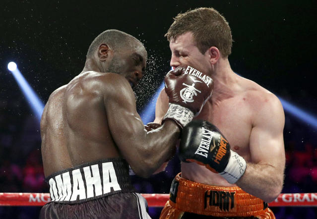 Jeff Horn, of Australia, fights Terence Crawford, left, in a welterweight title boxing match, Saturday, June 9, 2018, in Las Vegas. (AP Photo/John Locher)
